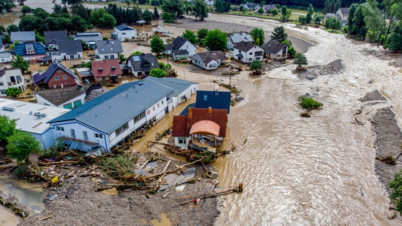 The floods caught many communities by surprise (Town of Insul) - source - AP PHOTO-MICHAEL PROBST